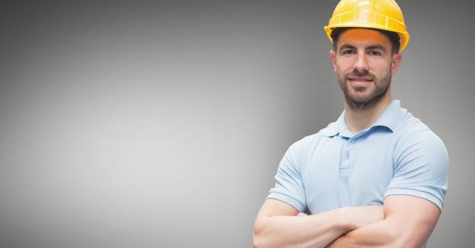 Portrait of worker standing with arms crossed #410271