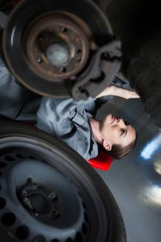 Female mechanic repairing a car #410273
