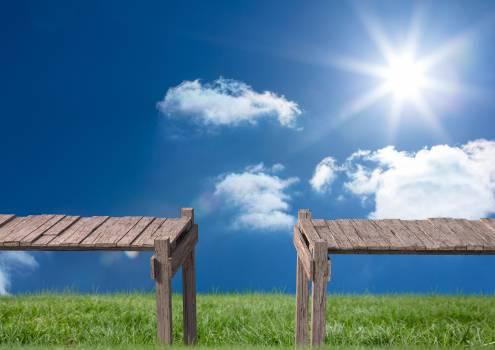 Separated wooden footbridges against sunny sky #410274