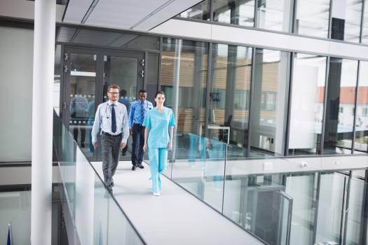 Doctors and nurse walking in corridor #410289