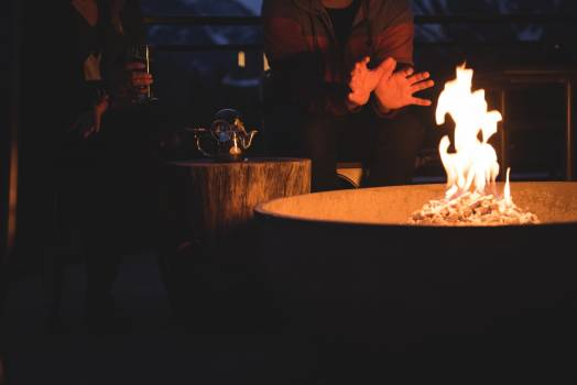 Couple sitting by fire pit  Free Photo