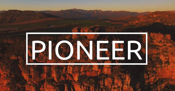 Pioneer text with eroded landscape in the background #410356