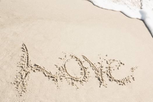 Love written on sand Free Photo