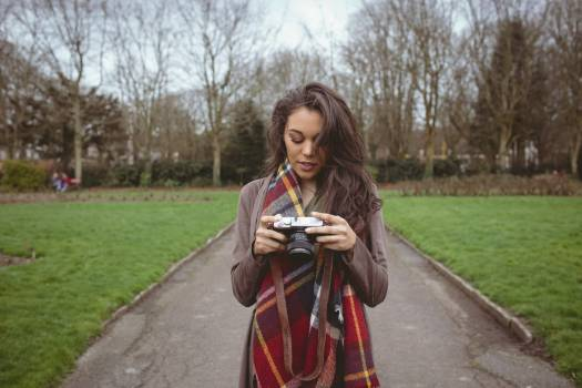Woman holding digital camera #410379