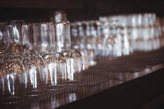 Empty glasses arranged on shelf in a bar #410456