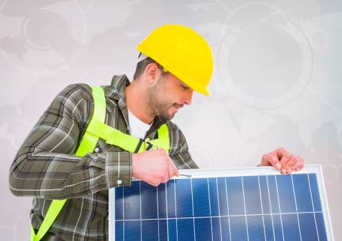 Man fixing solar panel against map background #410491
