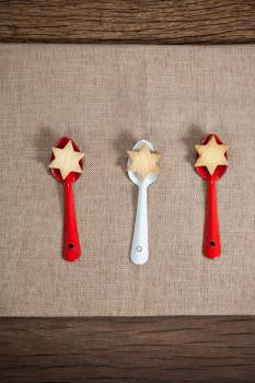 Red and white spoon with christmas cookies #410539