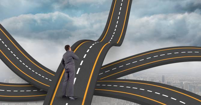 Digital composite image of businessman standing on wavy road #410622