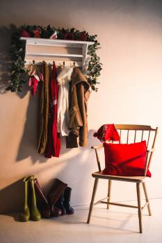 Winter clothes hanging on hook hanger and wooden chair #410716