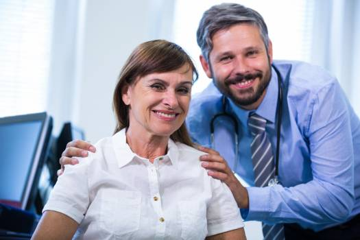 Portrait of a male doctor and patient Free Photo