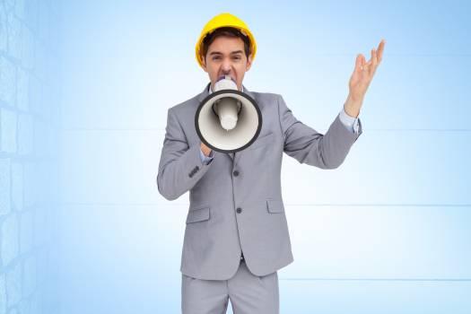 Architect screaming on megaphone Free Photo