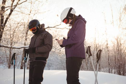 Skier couple using mobile phone  #410759