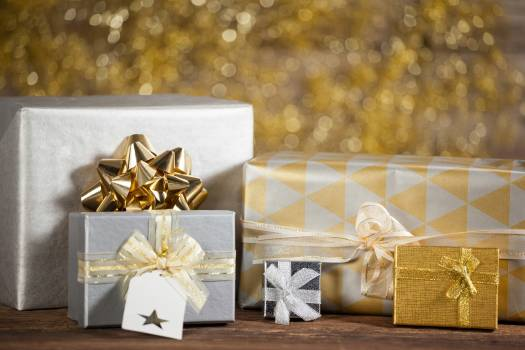 Close-up of various wrapped gift box on wooden table Free Photo