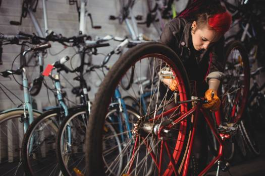 Mechanic repairing a bicycle #410878