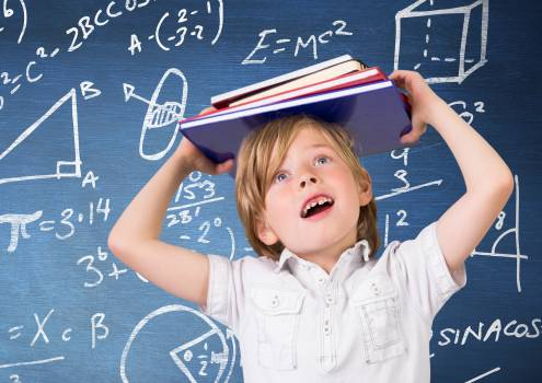 Boy carrying a stack of book against Blackboard with mathematical symbols and formula #410879