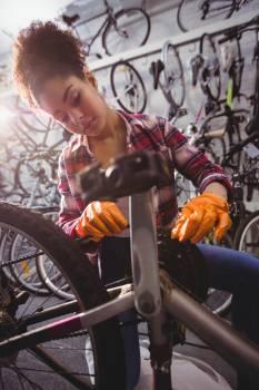 Mechanic repairing a bicycle #410954