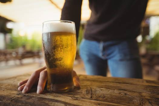 Mid section of man with glass of beer #410957