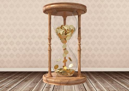 Hourglass with gold coins inside #410973