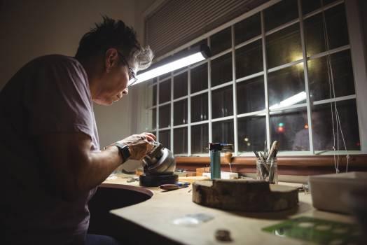 Craftswoman working in workshop #411008