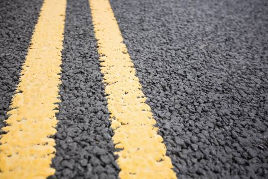 Yellow road marking on road surface #411035