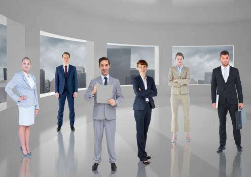 Business executives standing in room against cityscape background Free Photo