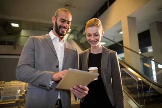 Businesspeople discussing over digital tablet Free Photo