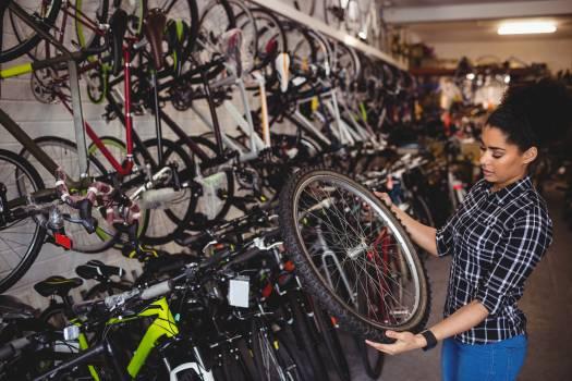 Mechanic examining a bicycle wheel #411100