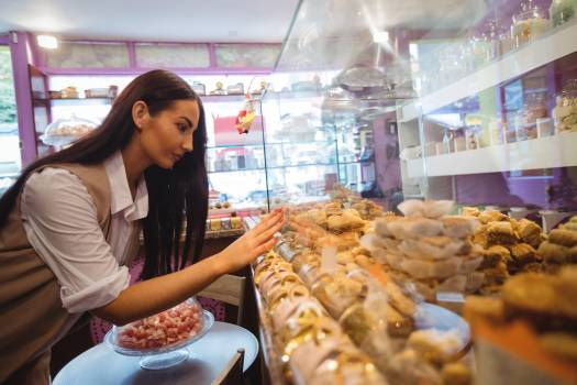 Woman looking at turkish sweets in shop #411162