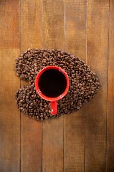 Coffee cup with heart shaped coffee beans #411189