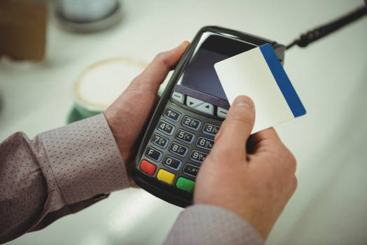 Hands making payment through credit card in cafe  Hands making payment through credit card in cafe   #411215