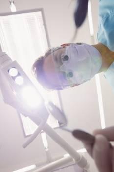 Dentist holding dental tools #411290