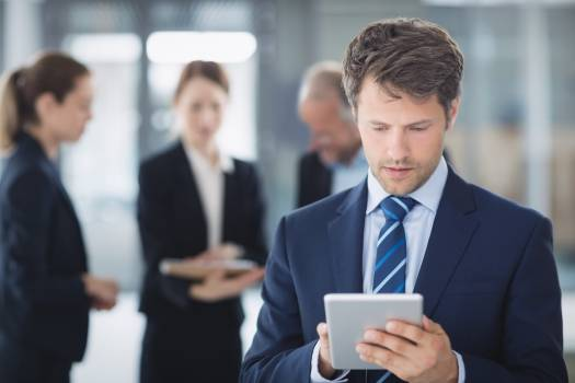 Businessman using digital tablet Free Photo
