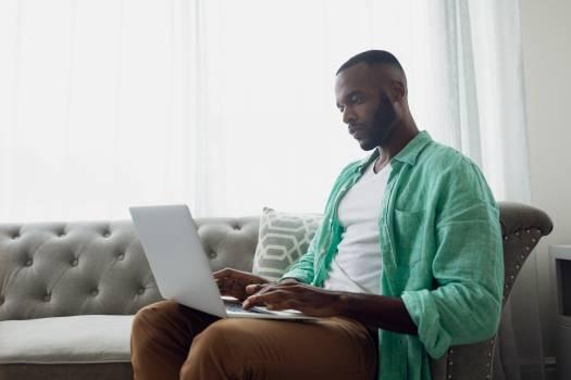 Man using a laptop Free Photo