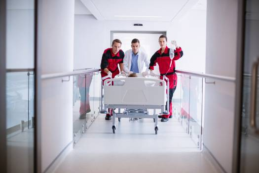 Doctors pushing emergency stretcher bed in corridor #411391