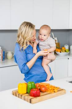 Mother holding her baby boy in kitchen #411393