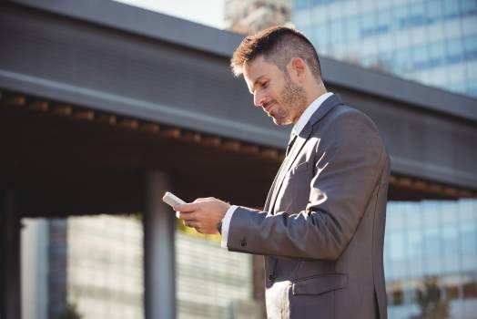 Businessman using mobile phone #411427