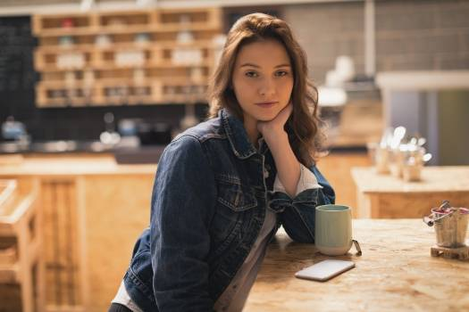 Woman sitting in café with coffee on table #411478