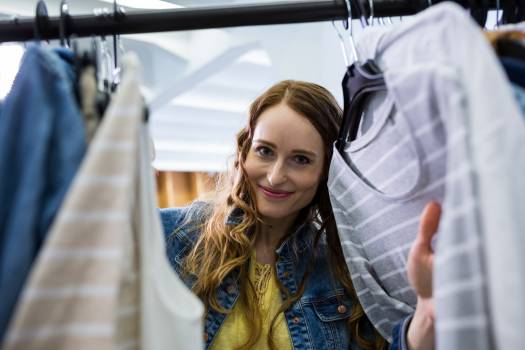 Woman choosing clothes from clothes rack #411497