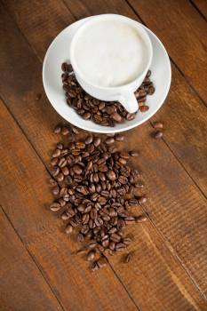 Cup of coffee with coffee beans and spoon #411514