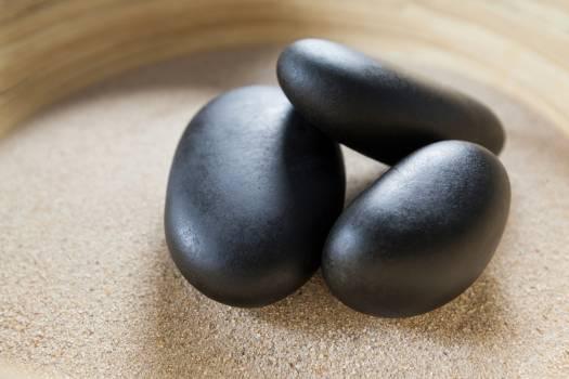 Three pebble stones on a sand #411619