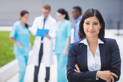 Female doctor standing with arms crossed #411646