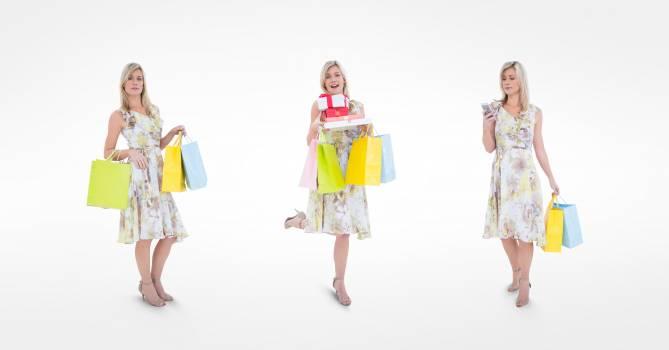 Multiple image of shopaholic woman against white background #411665