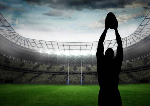 Silhouette athlete playing rugby in stadium #411668