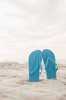 Blue flip flop in sand #411673