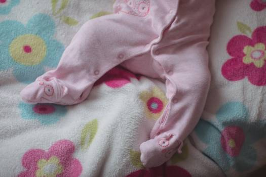 Low section of baby lying in bed #411675
