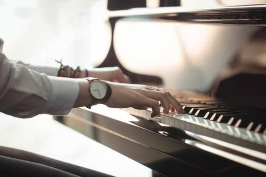 Woman playing a piano #411692