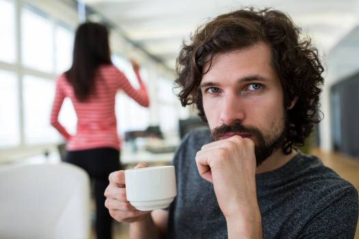 Portrait of male graphic designer holding a cup of coffee #411702