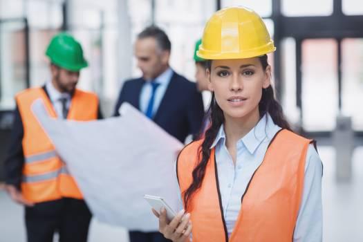 Female architect holding mobile phone #411729