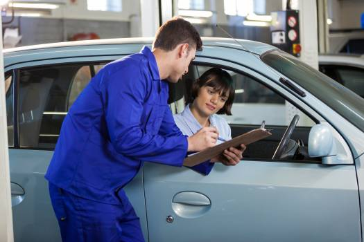 Mechanic showing the quotation to a customer #411746