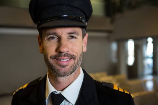 Smiling pilot at the airport terminal #411748